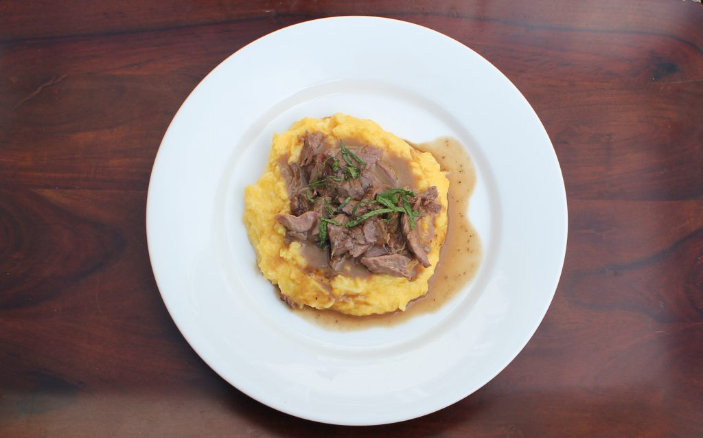 Guinness Lamb over Irish Cheddar Polenta