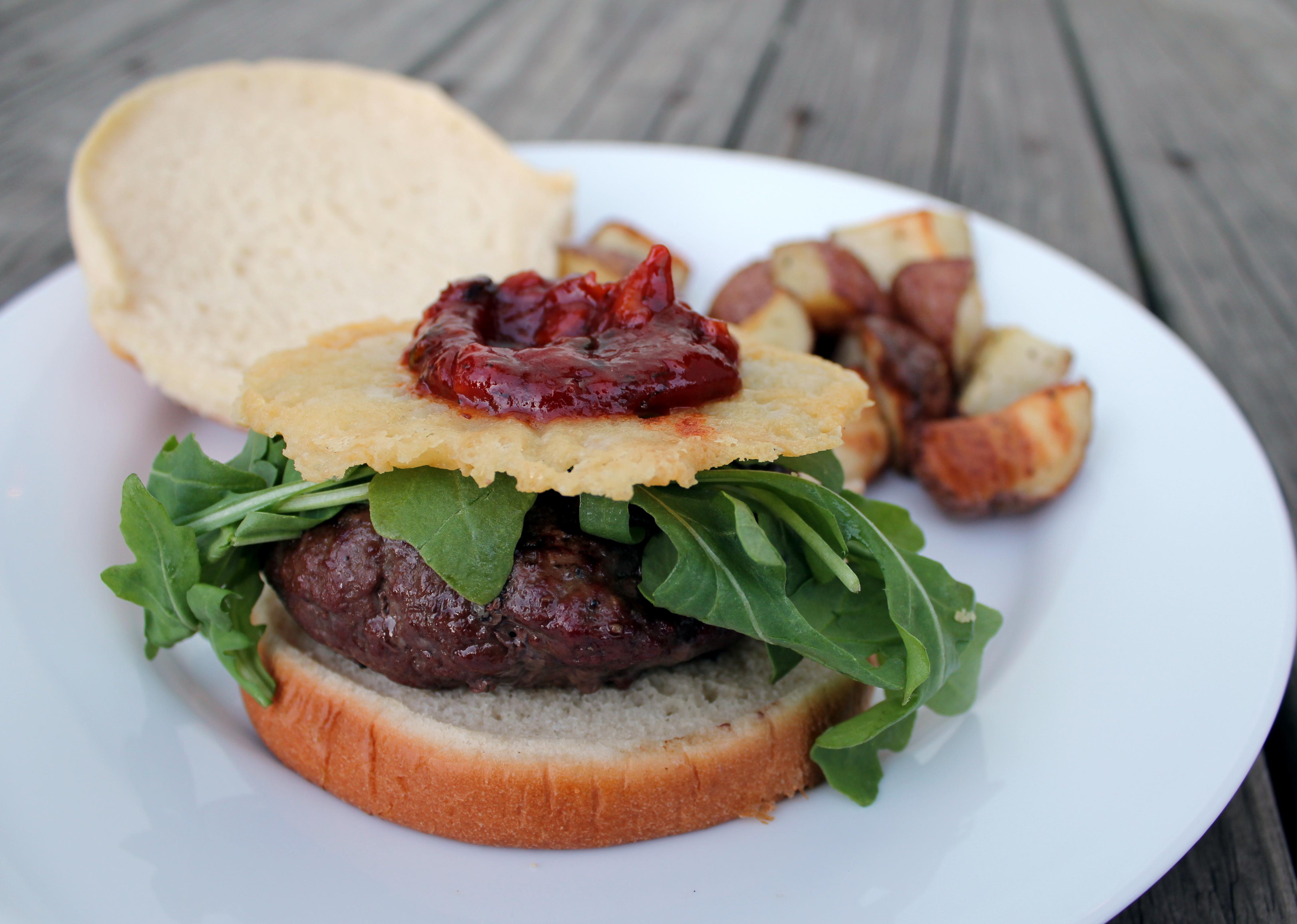 burger with arugula, asagio cheese crsip and spicy basil ketchup