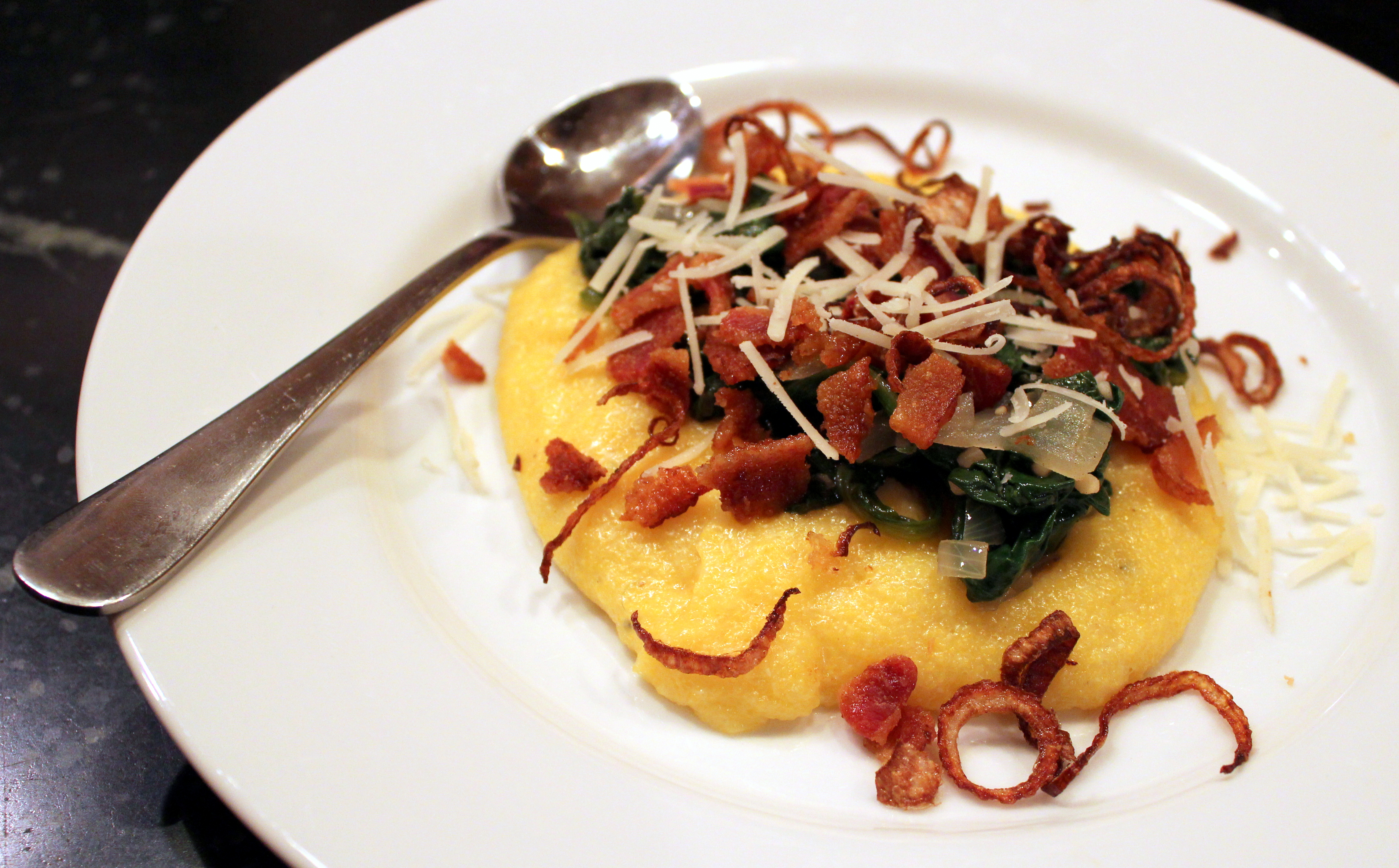 polenta with sauteed spinach and bacon with fried shallots
