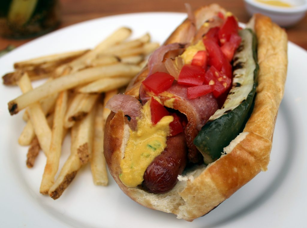 Bacon wrapped hot dog with grilled pickle